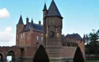 143928__de_wapentoren_met_leeuwen_van_een_Amsterdams_grachtenpand